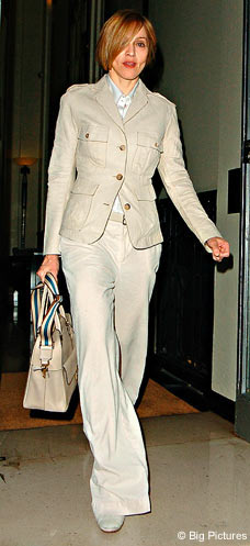 Madonna wearing a beige safari suit